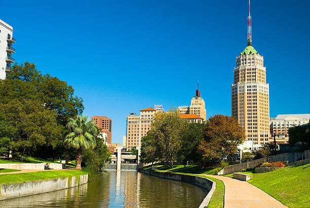 San Antonio Downtown Skyline and Riverwalk San Antonio downtown skyline (including the Tower Life building prominently shown) with the riverwalk in the foreground. san antonio texas stock pictures, royalty-free photos & images