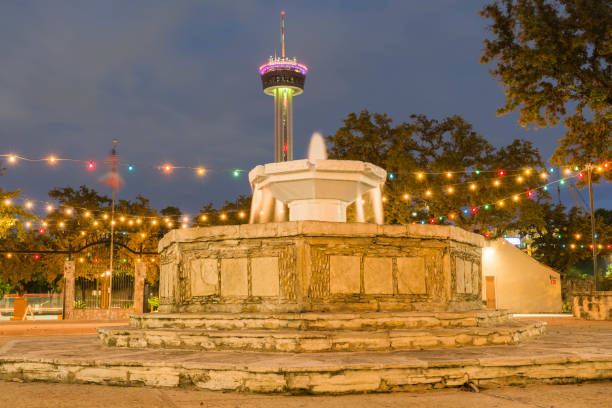 San Antonio La Villita Fountain with Tower in Background at Night Long Exposure stock photo