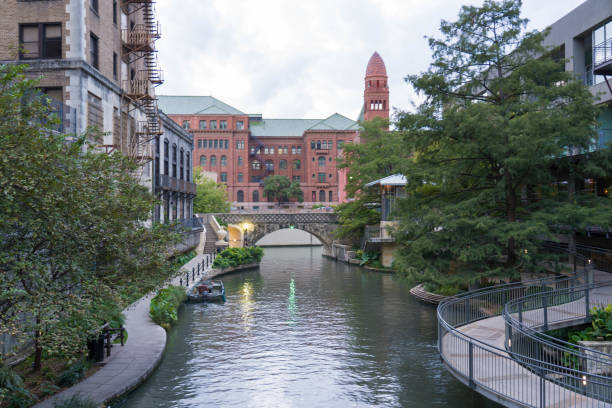 San Antonio River Walk with Court House in Background stock photo