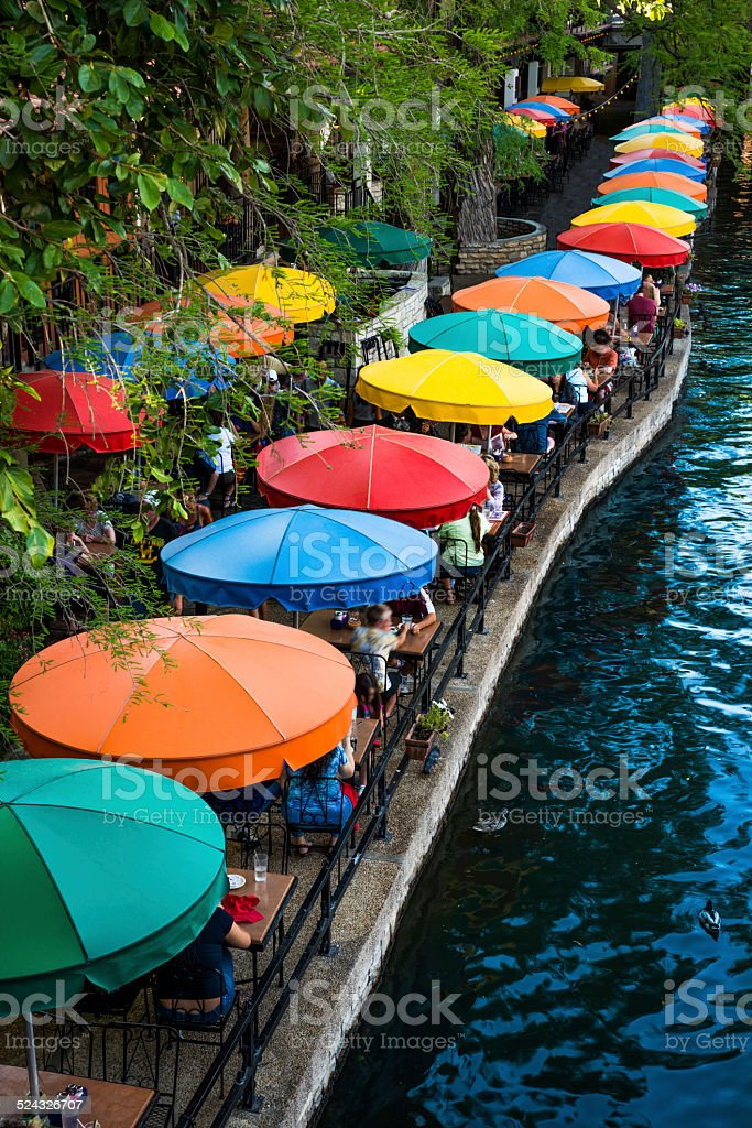 San Antonio Riverwalk, Texas, scenic river canal tourism restaurant umbrellas stock photo