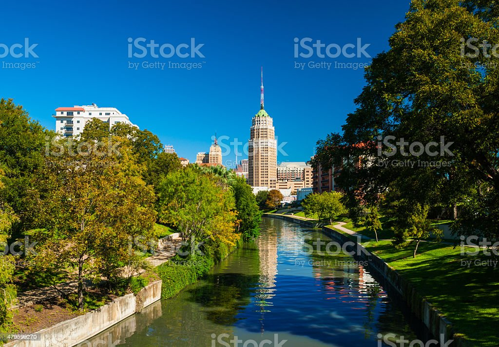 San Antonio skyline with riverwalk and lush trees stock photo