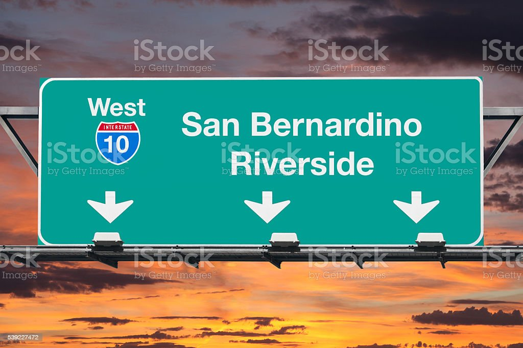 San Bernardino Riverside Interstate 10 West Highway Sign with Sunrise stock photo