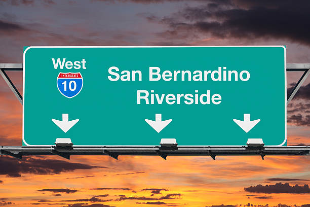San Bernardino Riverside Interstate 10 West Highway Sign with Sunrise San Bernardino Riverside Interstate 10 west highway sign with sunrise sky. san bernardino california stock pictures, royalty-free photos & images