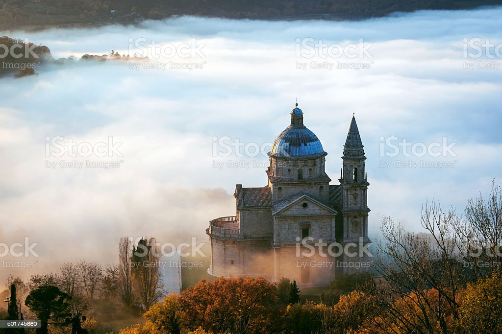 San Biagio before Sunset, foggy landscape, Montepulciano, Tuscany,Italy stock photo