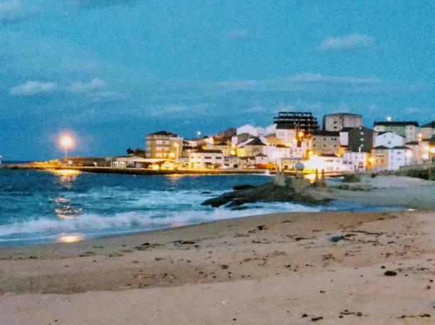 San Cibrao fishing village, beach and rocky coastline, Galicia, Spain. stock photo