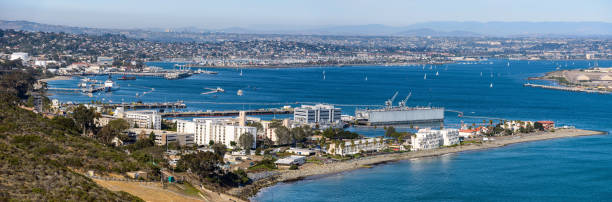 San Diego Bay - A panoramic overview of north San Diego Bay, looking from a high point in Cabrillo National Monument, on a sunny January afternoon, San Diego, California, USA. San Diego, California, USA - January 27, 2018: A panoramic overview of north San Diego Bay, looking from a high point in Cabrillo National Monument, on a sunny January afternoon. naval base stock pictures, royalty-free photos & images