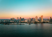 San Diego bay area cityscape with high buildings and the ocean at sunset