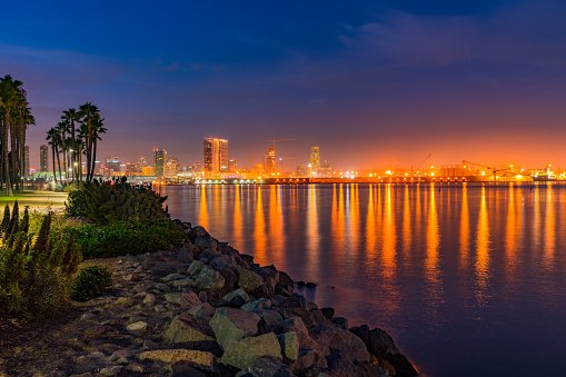 San Diego Harbor, night skyline, San Diego skyline, San Diego Bay, rocky shoreline, city lights, water reflection