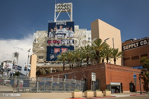 San Diego, California: Horizontal shot of the Petco Park (San Diego Padres baseball Park) exterior with billboards of players' photographs, Tony Gwynn Drive, East Village