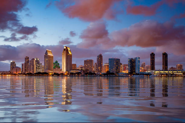 San Diego skyline at dusk reflected in sea stock photo
