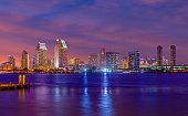 Dramatic harbor marina with recreational yachts and skyline of San Diego