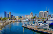 Dramatic harbor marina with recreational yachts and skyline of San Diego