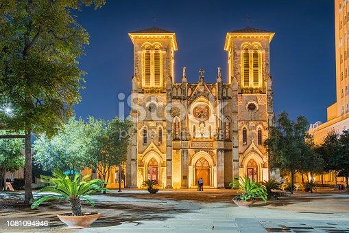 Stock photograph of the landmark San Fernando Cathedral in downtown San Antonio Texas USA illuminated at twilight blue hour