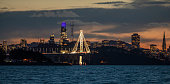 High quality panoramic stock photo of San Francisco from Oakland, California at dusk. Includes view of new Bay Bridge East bound extension with the Salesforce tower and SF skyline