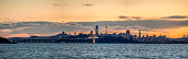 High quality large size  16,000 pixel panoramic stock photo of San Francisco from Oakland, California at dusk. Includes view of new Bay Bridge East bound extension with the Salesforce tower and SF skyline