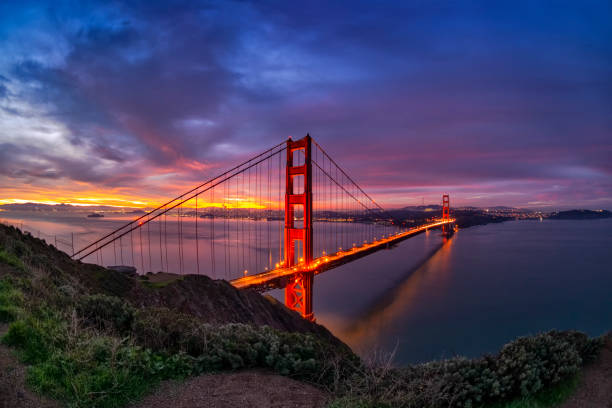 San Francisco Bay and Golden Gate Bridge at sunrise. Photo taken over a mountain at San Francisco Bay. The famous Golden Gate bridge. golden gate bridge stock pictures, royalty-free photos & images