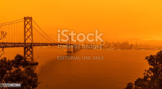 San Francisco California, USA - September 9, 2020: The sky across California darkened and stayed orange during day as smoke from many wildfires across the state created a massive smoke cloud changing the sunlight to a perpetual orange glow.