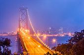 The Bay Bridge and the city of San Francisco California at dusk