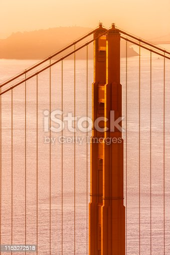 The Golden Gate Bridge in San Francisco California  with view of the Oakland Bay Bridge at sunrise
