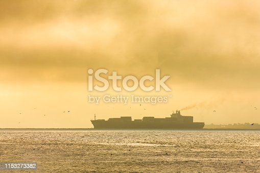 Freighter in the San Francisco Bay area of California at sunrise