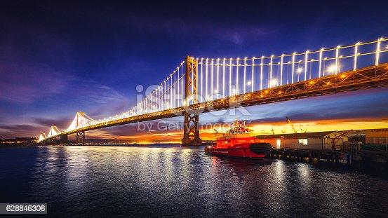 San Francisco Oakland Bay Bridge Illuminated at Sunrise, California