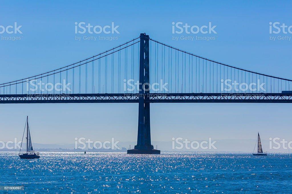 San Francisco Bay bridge sailboat from Pier 7 California stock photo