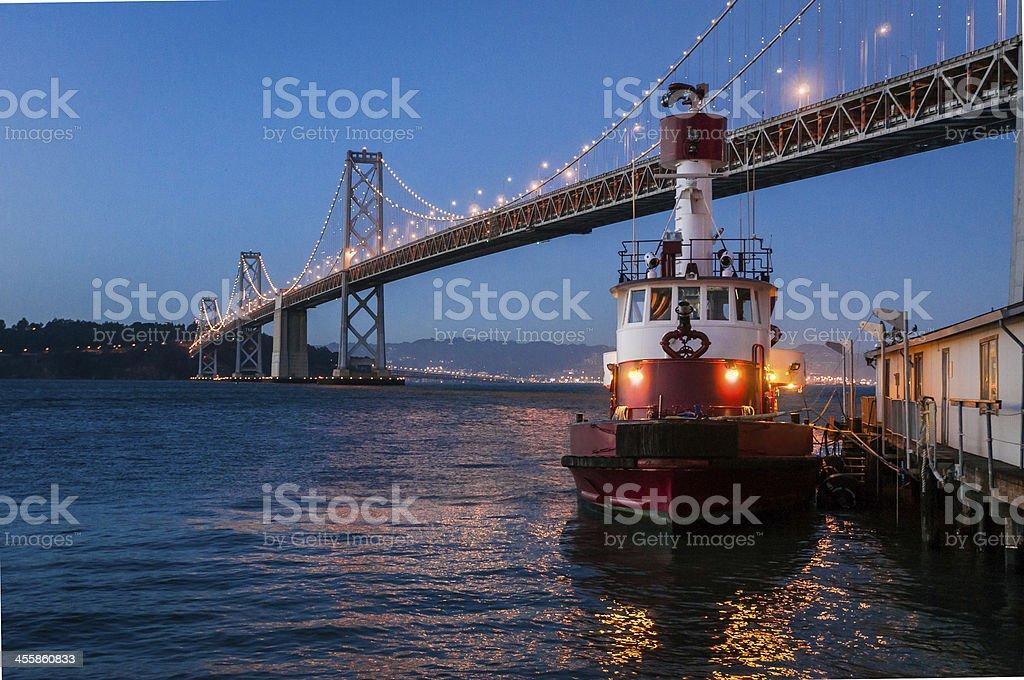 San Francisco Bay Bridge with Fireboat, Low ISO. stock photo