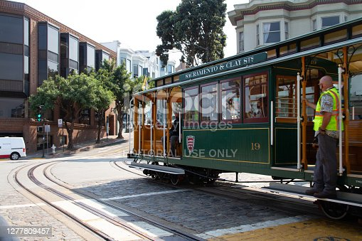 San Francisco, September 30th, 2020: Muni workers are test driving a commemorative large size cable car at the famous Ghirardelli Fisherman's Wharf