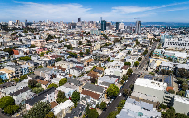 San Francisco California areial drone views above Dense Urban homes and Skyscrapers in 2nd largest city in America stock photo