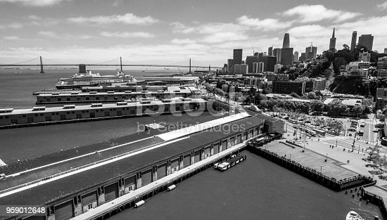 San Francisco , California , Bay Area black and white aerial drone view above harbor skyline cityscape with Oakland bay bridge - over pier 39 and looking towards Bay Area
