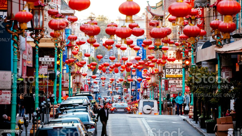 San Francisco Chinatown San Francisco, California, USA - May 18, 2018: People walking the colorful streets of Chinatown district. Building Exterior Stock Photo
