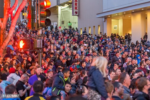 Chinese people parading at Chinese New Year parade in the streets of San Francisco. Crowd tourist are standing on the street watching the performance.