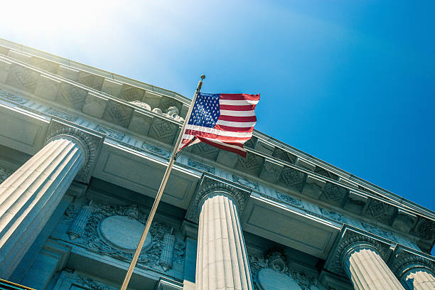 San Francisco City Hall entrance San Francisco City Hall entrance seen from below with a national flag. town hall stock pictures, royalty-free photos & images