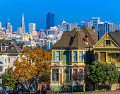 San Francisco cityscape with the Painted Ladies Victorian houses as seen from Alamo square park circa 2015