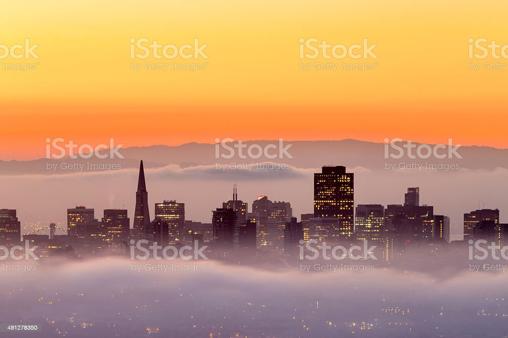 San Francisco downtown surrunded by low fog at Sunrise stock photo