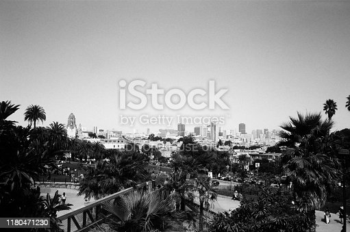 San Francisco, California, United States - October 06, 2019:  Black and white photo on true analog film of urban skyline of San Francisco taken from in Mission Dolores park in the Mission District neighborhood of San Francisco, California, October 6, 2019