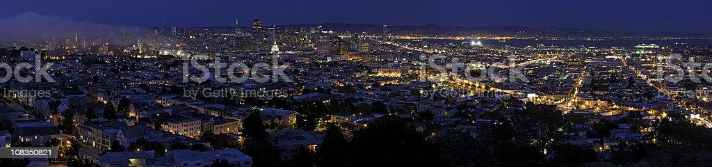 San Francisco glittering lights downtown illuminated blue dusk panorama California stock photo