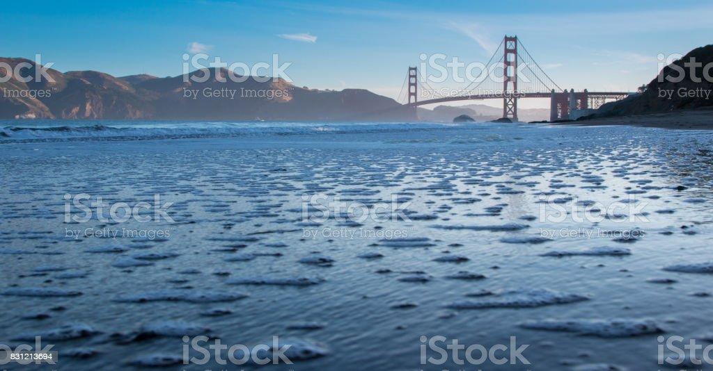 San Francisco Golden Gate Bridge from the Ocean in Baker's Beach stock photo