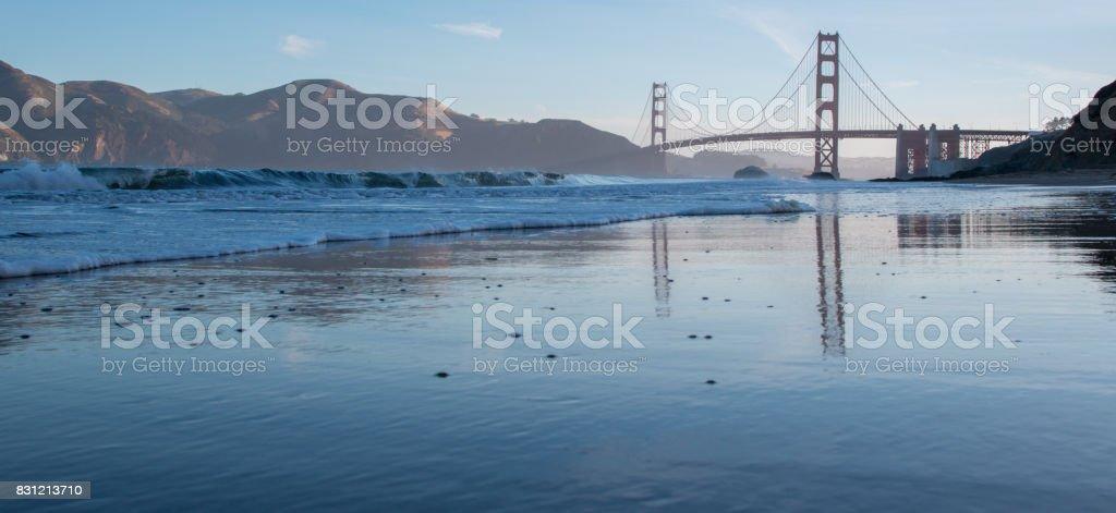San Francisco Golden Gate Bridge Reflected on Baker's Beach Wet Sand stock photo