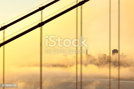 San Francisco in the Morning Mist, looking through the cables of Golden Gate Bridge.