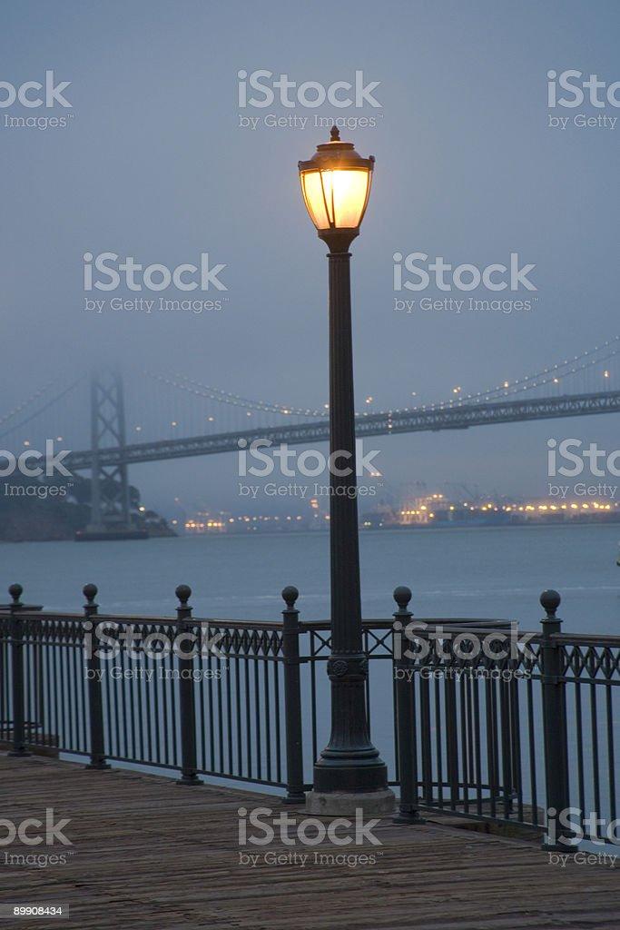 San Francisco: Lamp-post and Bay Bridge in Fog at Dawn royalty-free stock photo
