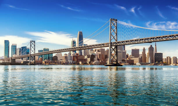 San Francisco on sunny day Downtown San Francisco and Oakland Bay Bridge on sunny day san francisco california stock pictures, royalty-free photos & images