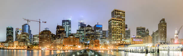 San Francisco Panoramic Skyline in foggy skies as seen from Pier 14. stock photo