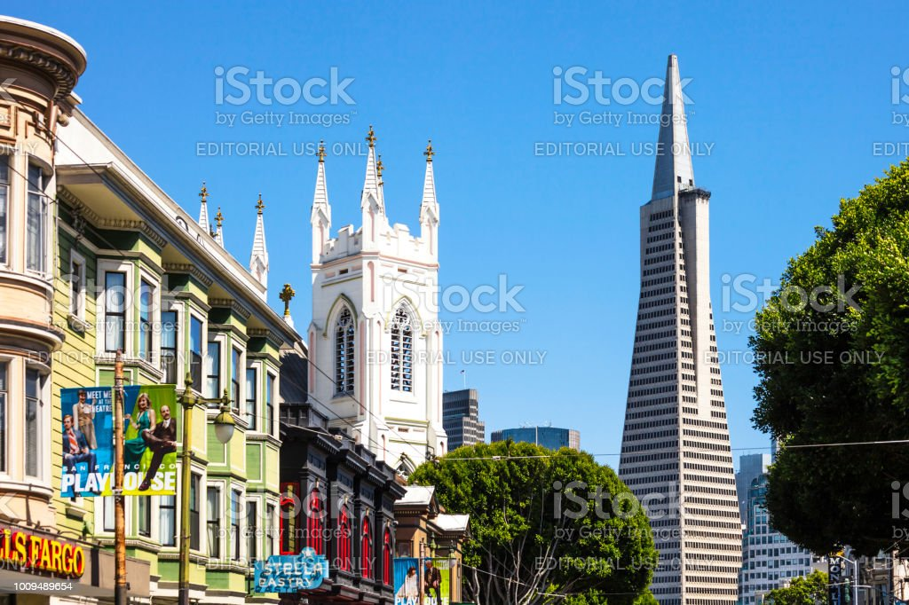 San Francisco San Francisco, California, USA - May 18, 2018: People walking the colorful streets of Little Italy district. Architecture Stock Photo