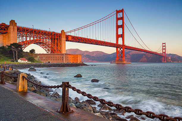 San Francisco. Image of Golden Gate Bridge in San Francisco, California during sunrise. golden gate bridge stock pictures, royalty-free photos & images