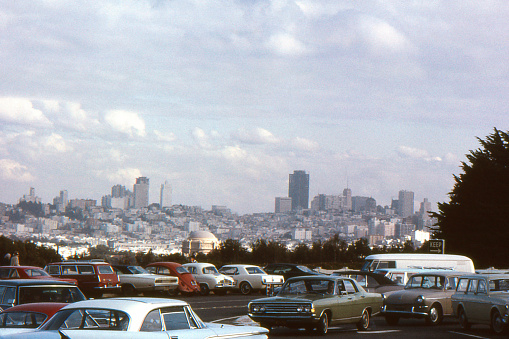 San Francisco, California, USA skyline in 1969. Bank of America Building, 555 California Street (tallest building right of center) was completed the same year. Domed Palace of Fine Arts in center front. Scanned film with significant grain.