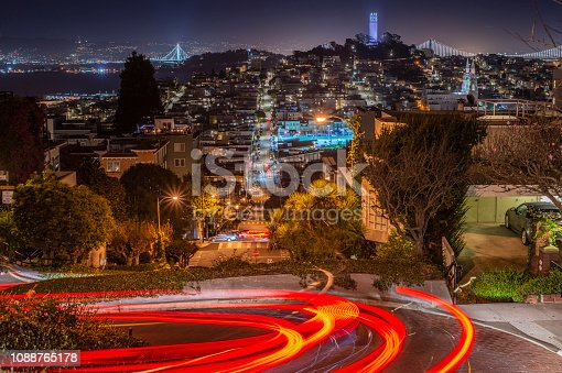 The image includes Coit tower and Eastern and Western sections of San Francisco-Oakland Bay bridge