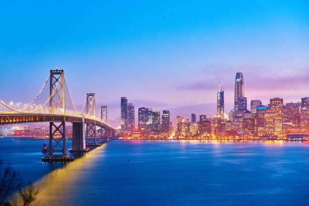 San Francisco Skyline at Sunset, California, USA San Francisco skyline at sunset, California, USA. golden gate bridge stock pictures, royalty-free photos & images