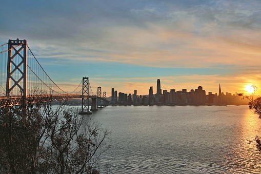 View of the San Francisco skyline at sunset from Yerba Buena island.