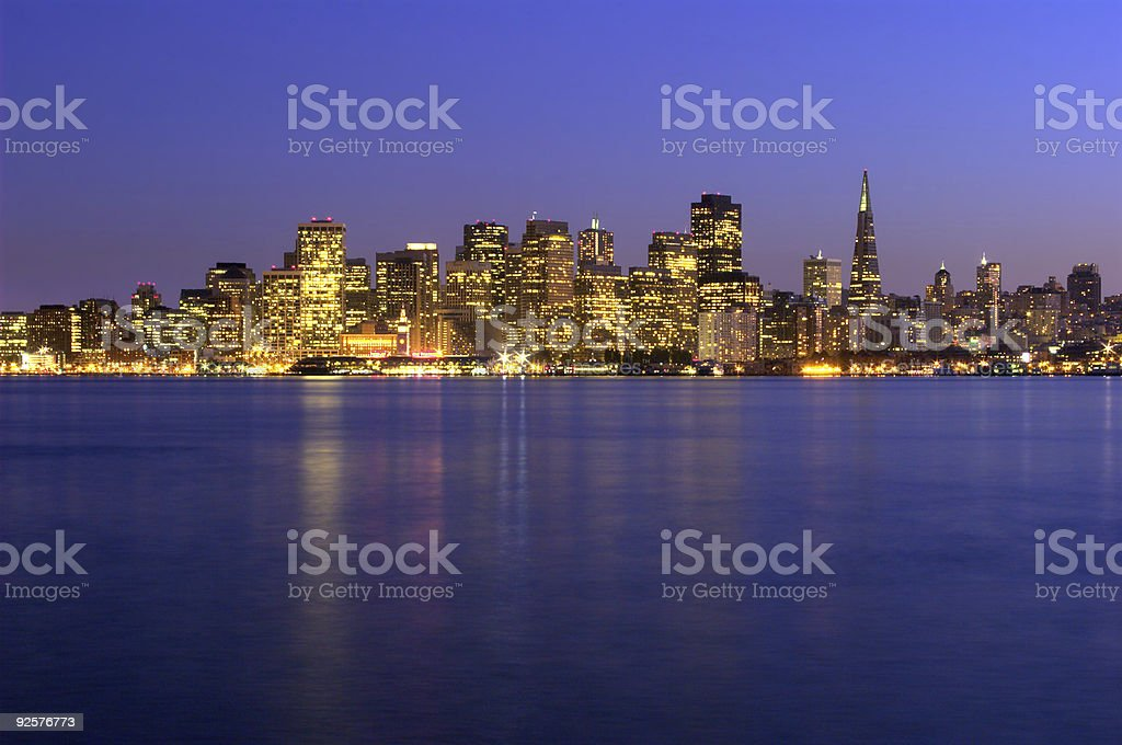 San Francisco skyline at sunset with the ocean in front stock photo